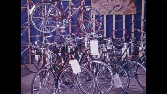1970s: Kids look at bicycles in bike shop.
