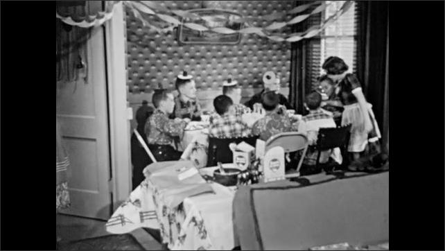 1950s: Box of stationary.  Address.  Birthday party.  Little boy runs back to table.  Children pass box around.