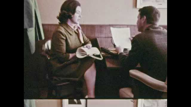1960s: Man and woman talking at desk. Close up of door, pan to people taking test, zoom in on man. Close up of application. Boy talks to woman in office.