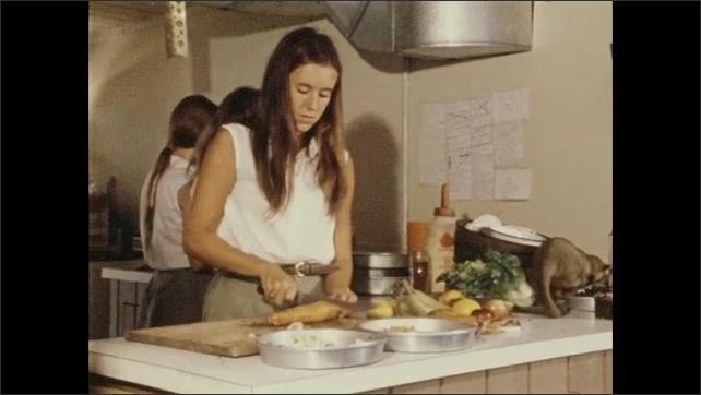 1970s: different zoo workers preparing food for animals