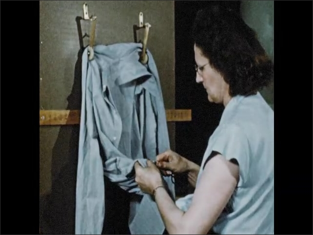 1950s: Woman inspects shirt collars. Woman inspects shirt. Women use machines to test fabric strength.