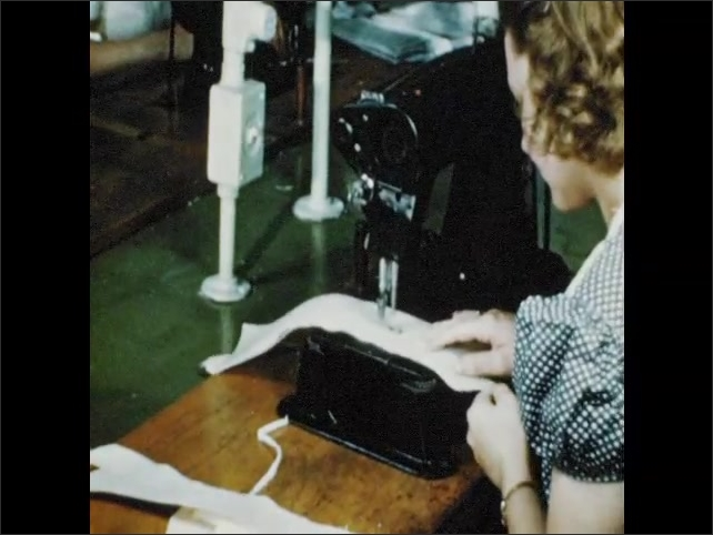 1950s: Women use machines to perform tests on textiles. Women sit at machines, sew fabric. Man folds shirt.
