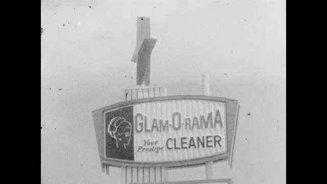 1960s: Star spins on top of sign. Parking lot and building. Sign spins. Dry cleaners.