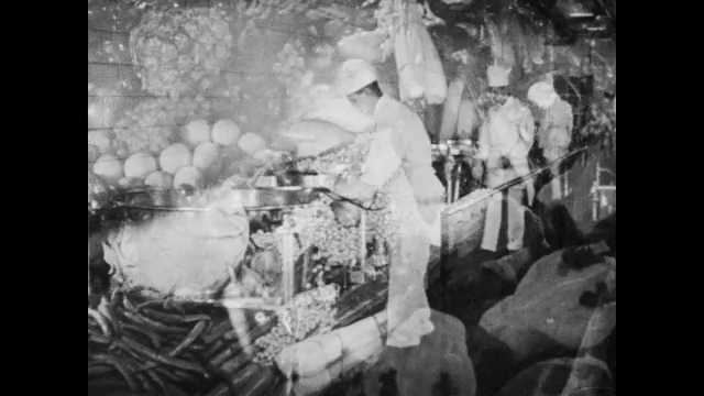 1950s: Montage of fruits and vegetables. Workers dump butter and cream into cooking vats. Workers separate vegetables on conveyor belt.