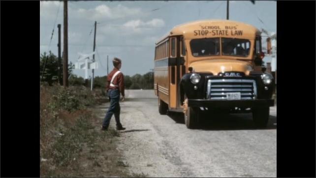 1950s: Boy jogs down road, bus follows behind. Bus stops, boy boards bus, bus drives away.