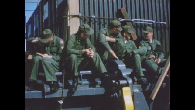 1960s: Soldiers sleeping, lounging on deck of Navy vessel. Soldiers talking to each other.