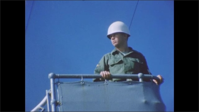 1960s: Soldiers hanging out, reading, on deck of Navy vessel. Soldiers on lookout. Bird flying. Bird flies over water.