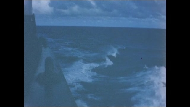 1960s: Wake of waves from Navy vessel at sea.