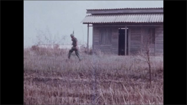 1960s Vietnam: Soldiers patrol small village with tanks.  Piece of paper.