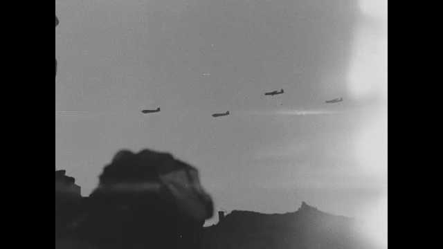 France 1940s: Pan of airplanes flying over ocean. Planes flying over beach. Pan of field hospital, wounded men on ground.