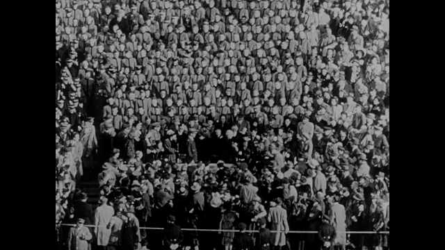 1950s: Crowd in arena. View of football game, player making touchdown. Low angle, men cheering. View of game. Long shot, crowd rushing field. Harry Truman sitting in stands.