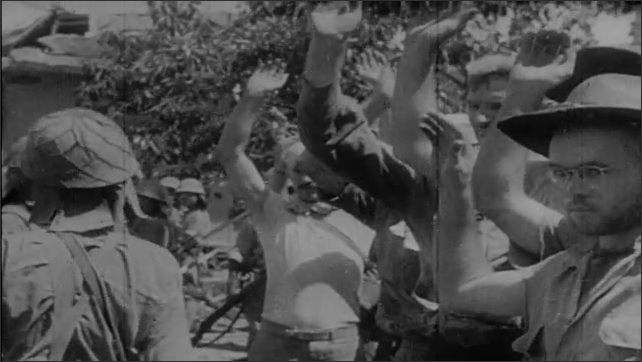 1940s: Japanese soldiers taking down American flag, posing on cannon, raising Japanese flag, soldiers marching