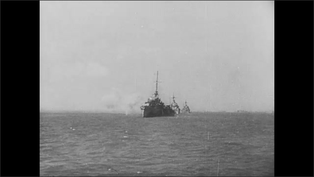 1940s: Bombs explode on ground. Planes drop bombs. Ships fire cannons. Assault boats travel towards shore. Soldiers run onto beach.