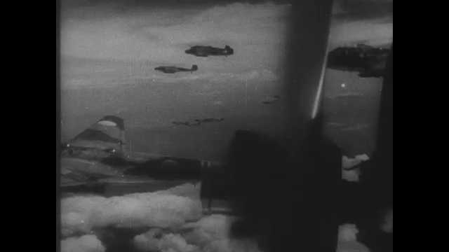 1940s China: Fighter jets in the air. Fighter jets drop bombs. People run. Explosions.
