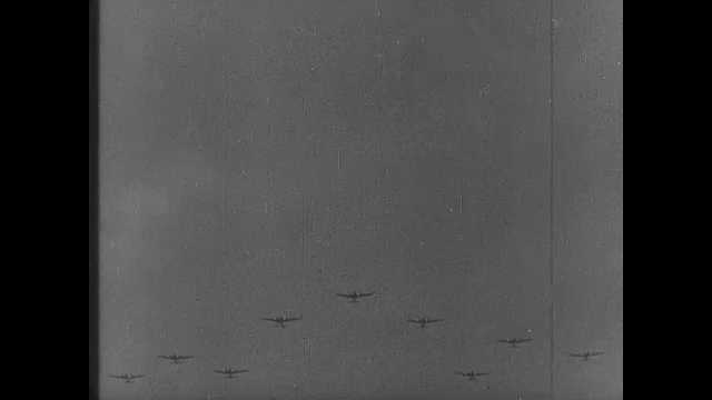 1940s: Squadron of bombers in sky. Harbor, bay. Town. People run through streets in town. Children in uniforms run for shelter.