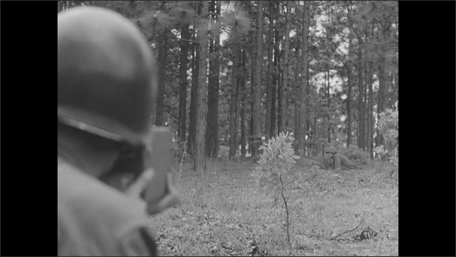 1950s: Soldiers supervise surrendered enemy soldiers.  Cameraman.  Satellite dish spins.  Man on tv set.  Man watches monitor in hall.  Man films in forest.  Troops march in parade.  Ships.