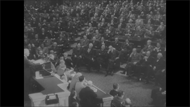 1950s Europe: President Truman addresses congress. Cars drive through Paris. French politicians meet and talk.