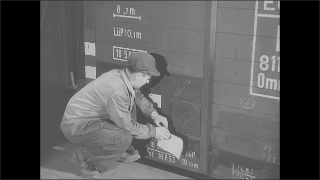 1950s: Workers in steel factory assist with liquid metal filling molds. Operators answer phones. Block of hot metal drops onto conveyor belt. Train pulls from factory. NATO headquarters. People.