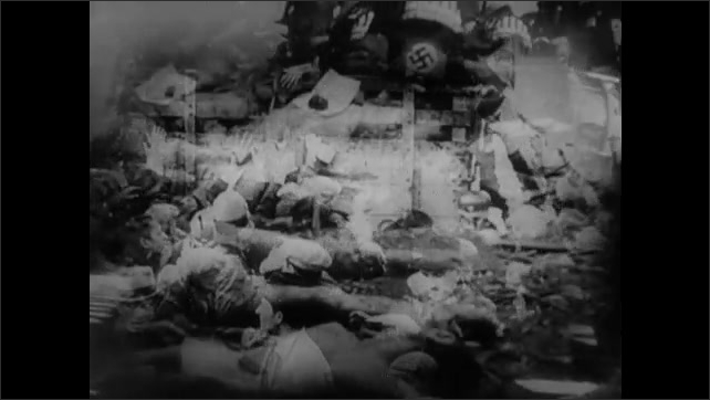 1940s EUROPE: Band plays. Nazis march in formation. Cemetery.  People walk with blindfolds. People on truck hand parcels to people in crowd. Dead bodies. Building burns. People cry. People hanged.