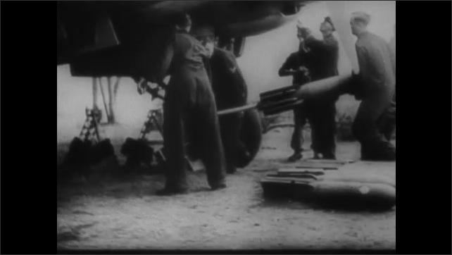 1940s ENGLAND: Train departs station. Man gestures at map. Officers speak. Men walk under fighter jet. Jet takes off.