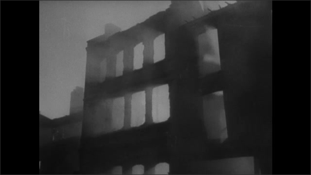 1940s ENGLAND: Flashes in sky. Church steeple. Smoke rises from ground amid destruction.
