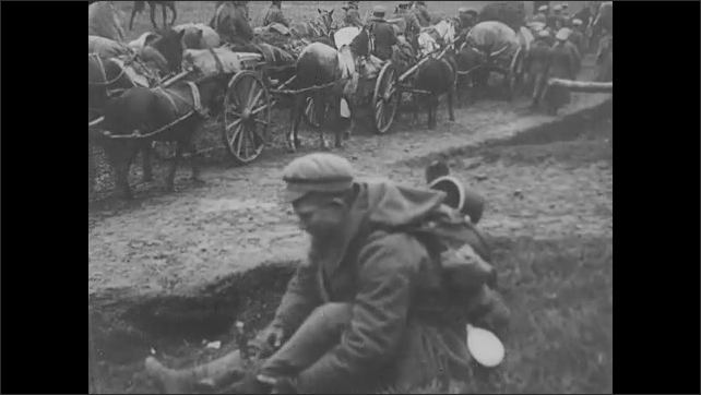1910s: Soldiers greet, embrace each other. Horses pull wagons down dirt road with soldiers. Train pulls into station with people sitting on top of cars. Intertitle.