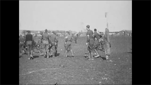 1910s: Intertitle. People play game with balls on field.