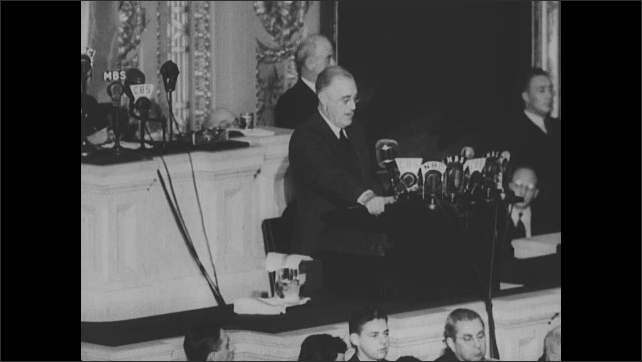 1940s: Title. Congress claps as president gives speech. President gives speech to congress.