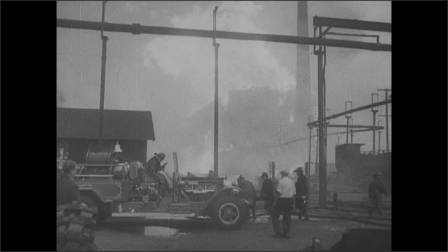 1940s: Capitol Building in Washing D.C.. Crowd of people. President in sworn in before crowd. Intertitle. Factory building burns on fire. Building collapses. Sailors march onto boat.