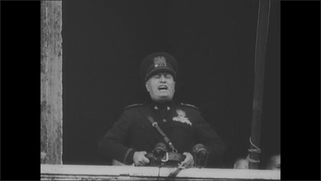 1940s: President signs paper. Nazi rally. Hitler gives speech. Mussolini gives speech from balcony to crowd in street. President Roosevelt buys bond from man.