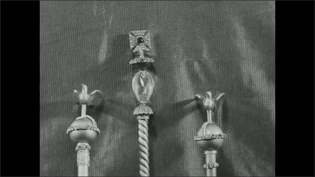 1930s: Replicas of British Crown Jewels on display. Title card.