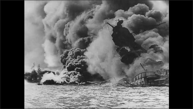 1940s: Squadron of airplanes fly in sky. Navy ships in ruins along docks. Smoke and fire rise from Navy ship. Navy ship with fire and destruction in distance.