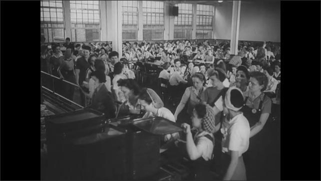 1940s: Women get into car.  Neighborhood.  Crowded cafeteria.  Women wash hands.  Women leave factory.  Women work with machines.