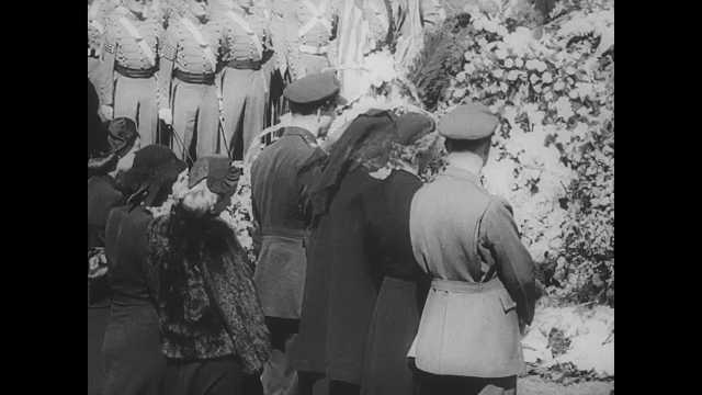 1940s: Outdoor funeral at Springwood in Hyde Park, NY. Seven gun salute from Marines. Priest procession after funeral.
