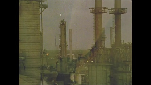 1970s: Power plant. Oil refinery. Oil pumped into pond.