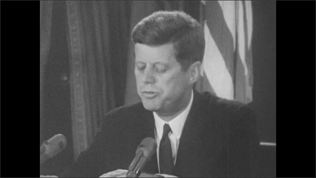 1960s: President John F. Kennedy gives a nationally broadcast speech from Oval Office in the White House.