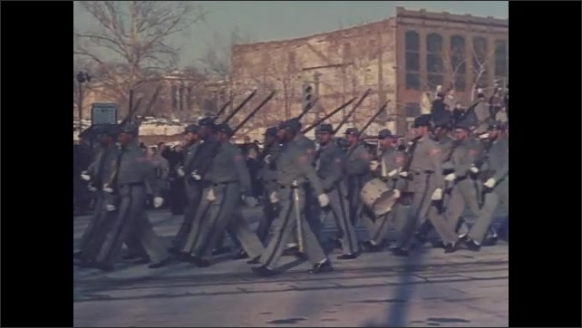 1960s Washington DC: Parade, soldiers in Confederate Civil War uniforms march, carry US, SC, Confederate flags, rifles. NH parade float, Live Free or Die, Old Man of the Mountain, fir trees.