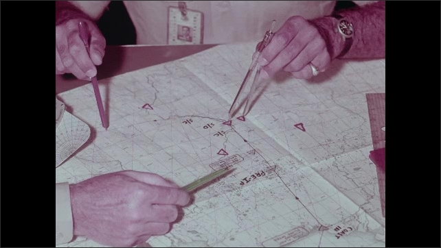 1960s: Hands pointing to positions on map.