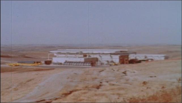 1960s: Military complex on barren ground.