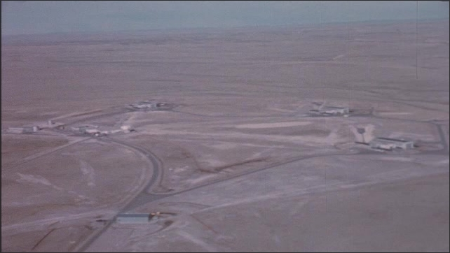 1960s: Aerial view of military ICBM complex in desert.