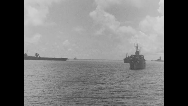 1940s: Film slate. Fleet of Navy ships at sea.