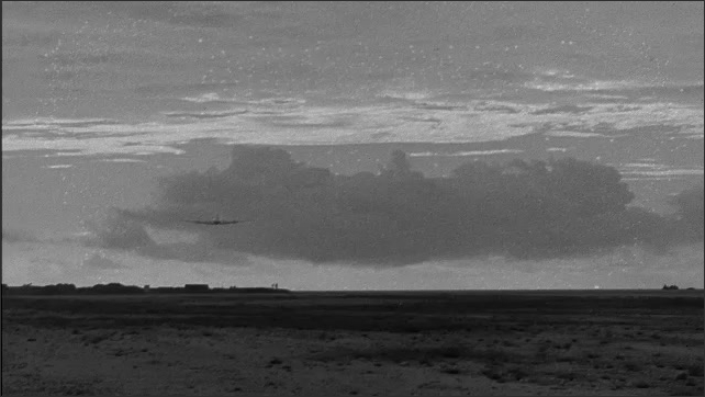 1940s Bikini Atoll: Plane flies away.
