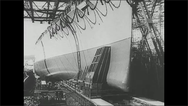 1940s: Nazi's launch Bismarck battleship. Winston Churchill and military officer walk up to building, enter building. Man taps out morse code on machine.
