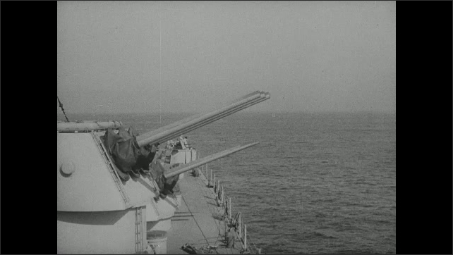 1940s: Cannons fire from deck of ship.