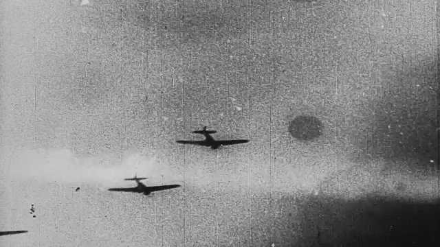1940s Japan: Formation of fighter planes in the sky. Stormy, cloudy sky.