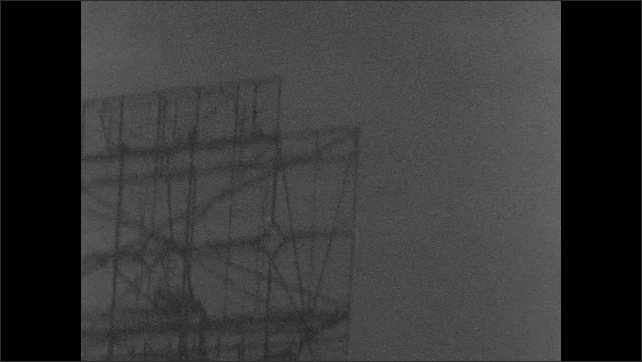 1940s: Explosion in water, water sprays into air. Plane flies by ship. Fireball flies through sky. Man stands on ship, watches fireball.