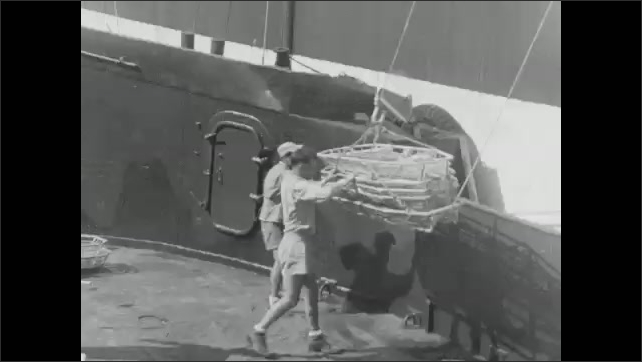 1940s: Men transport patients on and off ship with pulley system.