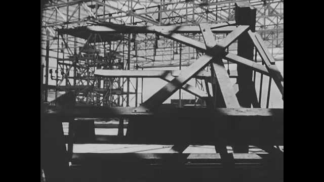 1941 Pearl Harbor: View of destroyed building frame, tilt down to floor. Soldiers running toward fire, pan to smoke.