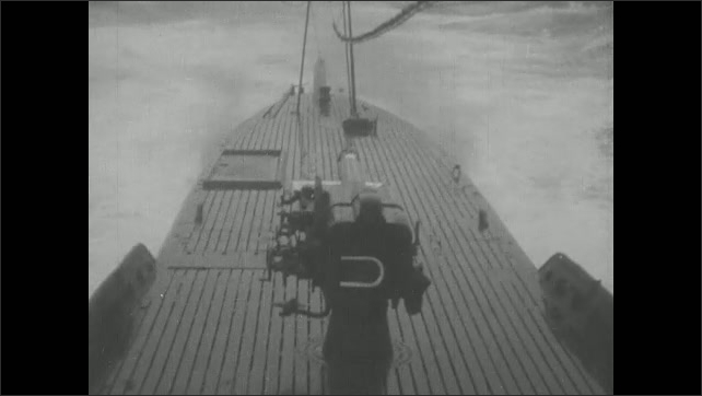 1940s Japan: submarine sailing, men operating controls and sending signals to each other
