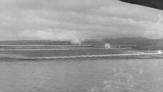 1941 Pearl Harbor: Smoke on the water. Wreckage of submarine. Wreckage of ship.